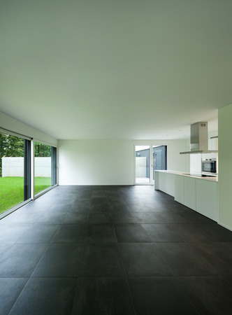 tiled: interior of empty apartment, wide room with kitchen