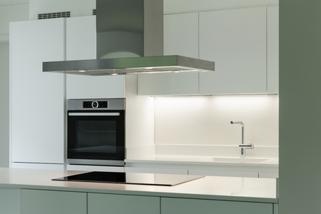 interior of new apartment, white domestic kitchen