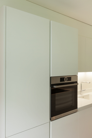 kitchen cabinets: interior of a domestic kitchen, cabinets and oven