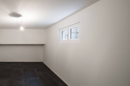 basement: Architecture, modern house, empty room with tiled floor black Stock Photo