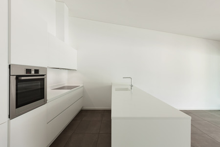 real kitchen: interior of new apartment, modern domestic kitchen Stock Photo