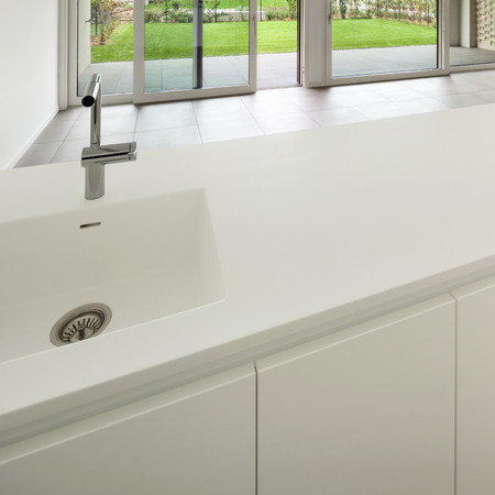 counter top: Interior, modern domestic kitchen, white counter top