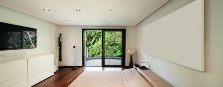 ceiling light: Interior of modern house, bedroom with balcony