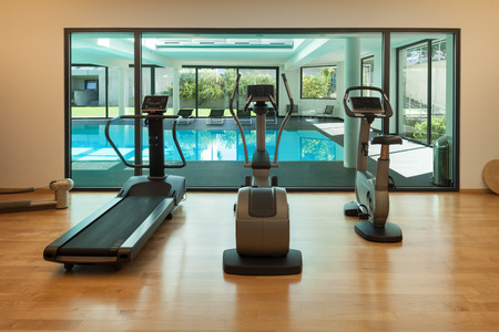 Interior, gym of a modern house with spa