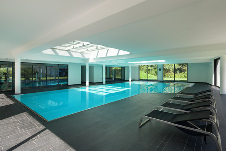 interior architecture: indoor swimming pool of a modern house with spa