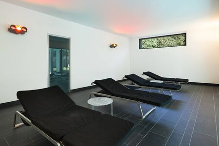 sunbed: interior of a modern spa, room with sunbeds