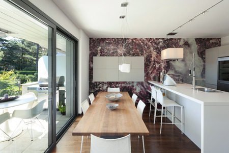 ceiling lamp: Interior of modern house, beautiful open space, kitchen and dining table