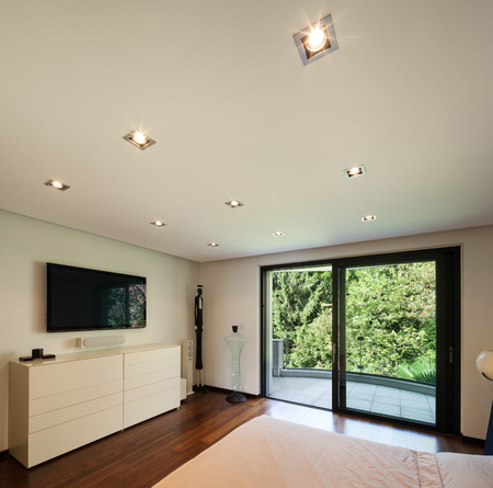 ceiling: Interior of modern house, bedroom with television