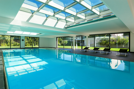modern design: indoor swimming pool of a modern house with spa