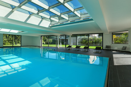 swimming pool home: indoor swimming pool of a modern house with spa