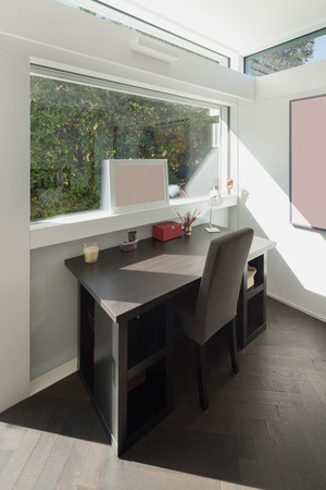 modern interiors: House, modern interiors, sunny studio of artist, desk and chair Stock Photo