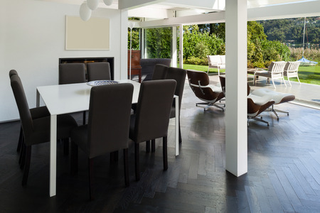 hardwood: Architecture, open space of a modern house,  dining table with chairs