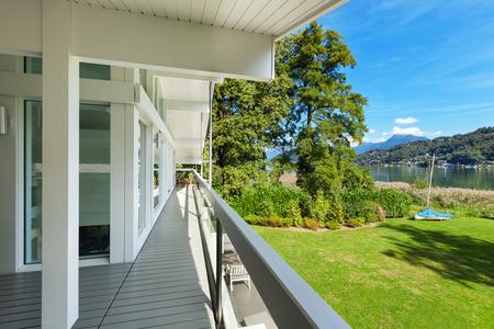 balcony window: long balcony of a villa on the lake, park view