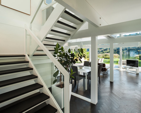 hardwood floor: Architecture, open space of a modern house,  living room view from stair