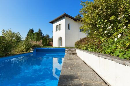 white house: White house in classic style with swimming pool