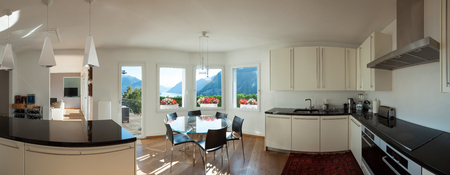 domestic kitchen: Interior of a furnished house, kitchen and dining room with glass table Stock Photo