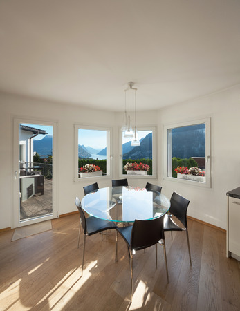glass table: Interior of a furnished house, dining room with glass table