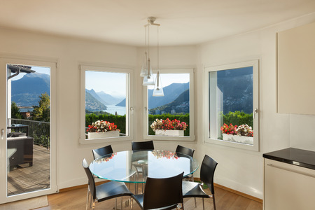 round: Interior of a furnished house, dining room with glass table