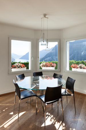 furnished: Interior of a furnished house, dining room with glass table