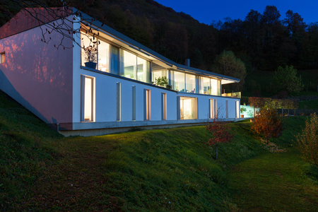 house windows: Beautiful modern house by night, view from the lawn
