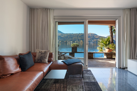 balcony window: Interior of house, modern living room, leather divan
