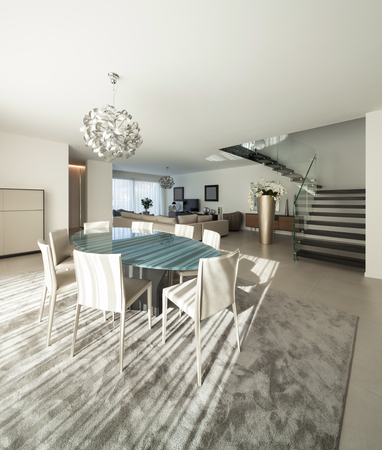 dining table and chairs: Interior of a modern apartment, comfortable living room