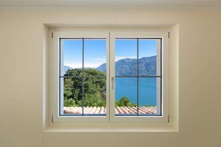 Interior of a new apartment, panoramic window on the lake