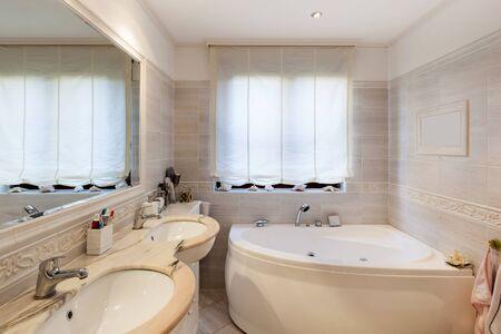 modern bathroom: Bathroom of a modern apartment, marble cladding