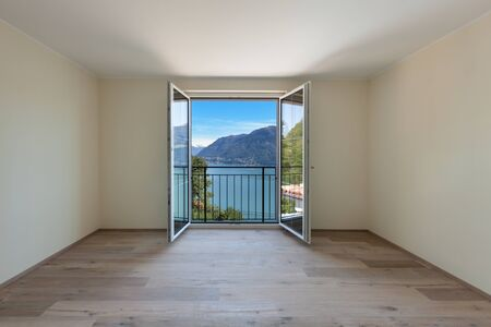 contemporary house: Interior of a new apartment, panoramic window on the lake