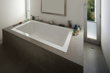 nice house: modern house, nice bathtub in a bathroom with window Stock Photo