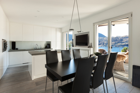 kitchen island: Interior of house, modern kitchen with black dining table