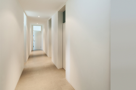 interior spaces: Interior of a modern house, corridor with many doors Stock Photo