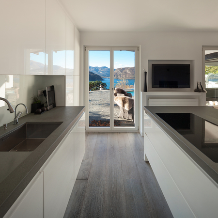 housing styles: Interior of house, modern kitchen with induction stove