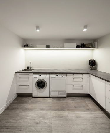 Interior of house, laundry with wooden floor Banco de Imagens - 52266996