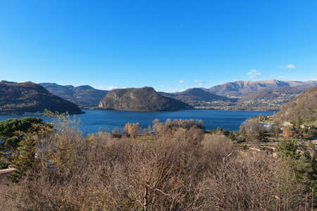 panoramic sky: panoramic view of Lugano Lake, blue sky Stock Photo