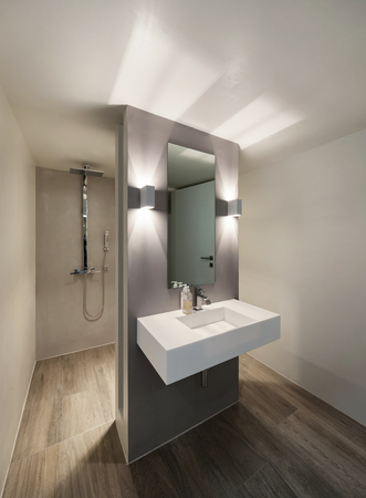 Modern bathroom, new trend design, sink with mirror Reklamní fotografie