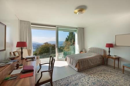 Architettura, confortevole camera da letto di una casa moderna