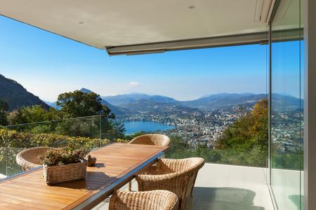 veranda: beautiful veranda with wooden table and wicker chairs,  panoramic view