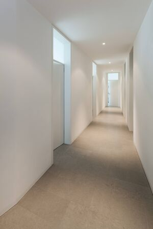 many doors: Interior of a modern house, corridor with many doors Stock Photo