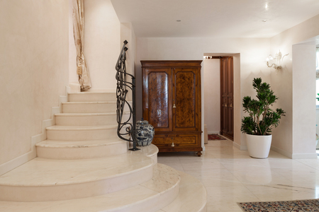 light interior: Hall of a luxury mansion, marble staircase