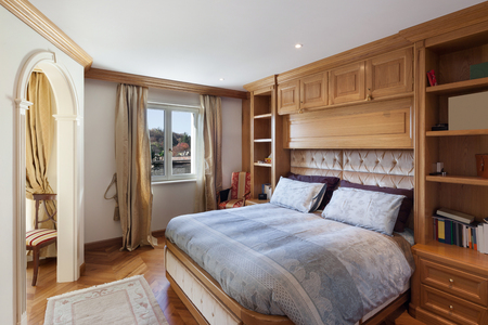 classical style: comfortable bedroom of house in classical style