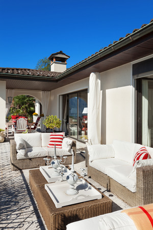 outside house: nice terrace of a villa with comfortable divans Stock Photo