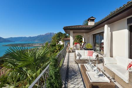 destinations: nice terrace of a villa, lake view