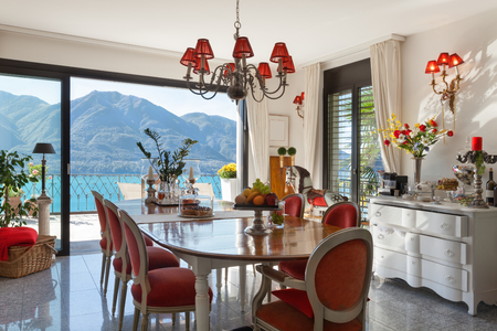modern dining room: Interior of house, table and chairs of a dining room with classic decor