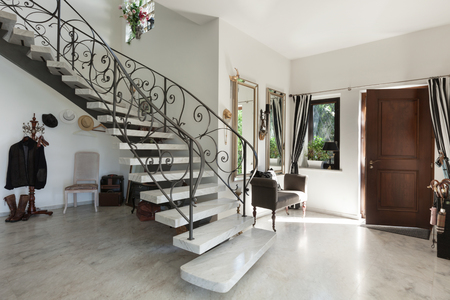 House Interior with staircase in large hall with marble floor