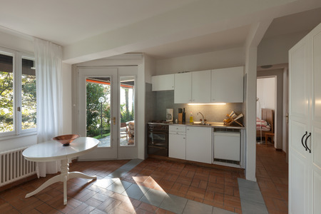 window open: Interior domestic kitchen of a rustic house Stock Photo