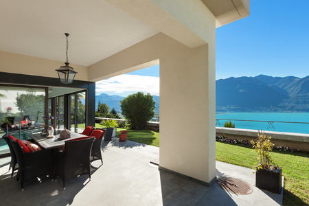 veranda: Architecture nice porch with table and chairs with lake view Stock Photo