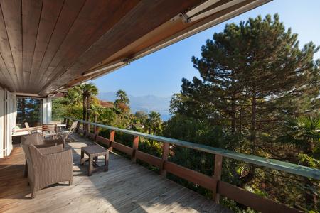 pine forest: veranda of a mountain home, exterior view