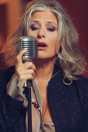 mature women: woman portrait, singer with microphone