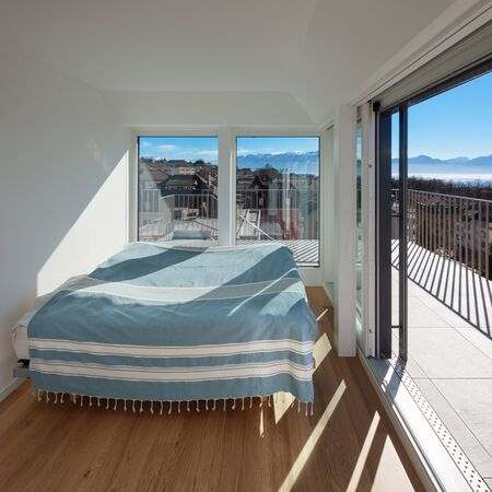 wide open spaces: Interior, bright bedroom of a new house Stock Photo